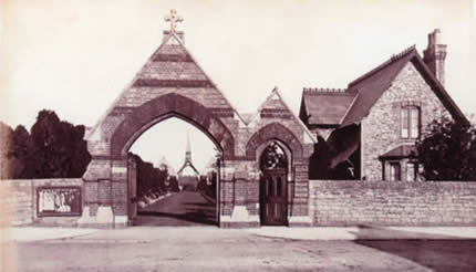 The cemetery gates, the Lodge, the central driveway and the two chapels with the covered porch and bell tower